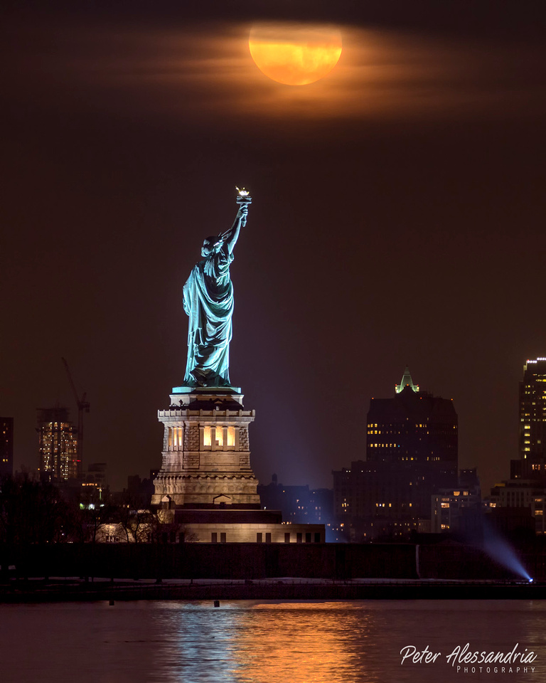 Snow Moon over Statue of Liberty
